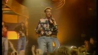 Top of the pops performance from 1989. lovely shirt, jason.....