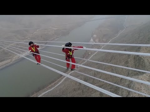 Workers Maintain World's Highest-voltage Power Line across Y