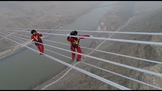 Workers Maintain World s Highest voltage Power Line across Yellow River