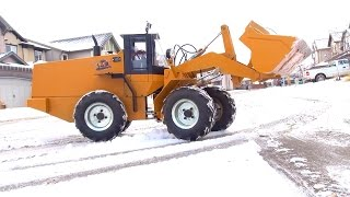 RC ADVENTURES - 500lb RC Wheel Loader clearing Snow- First Practice