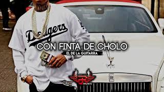 El de la guitarra CON FINTA DE CHOLO