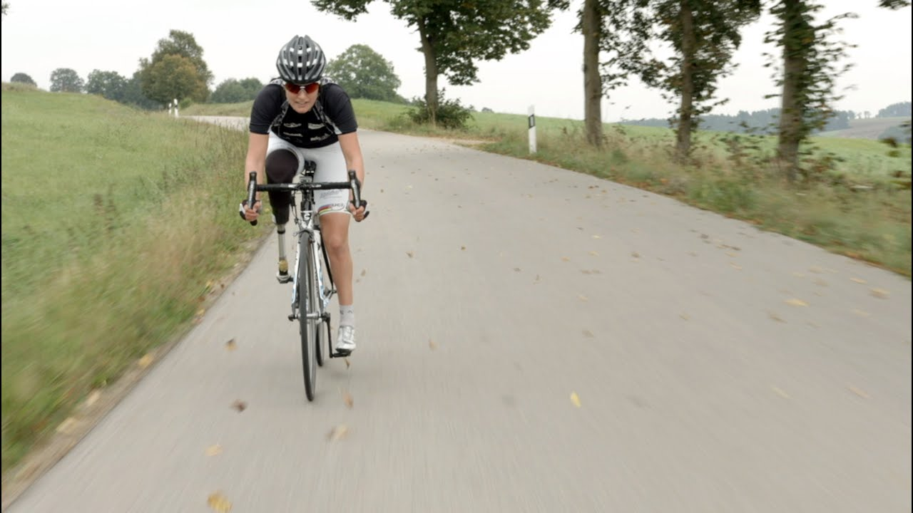 Denise Schindler cycling with her 3D printed prosthetic