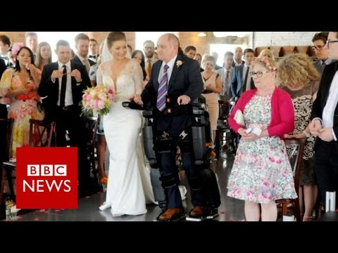 Paralysed man in bionic suit walks daughter down aisle - BBC News