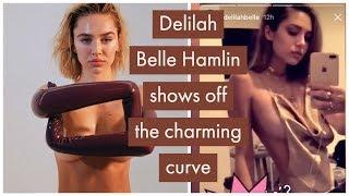 Delilah Belle Hamlin goes completely topless as she strikes pose wearing PVC gloves