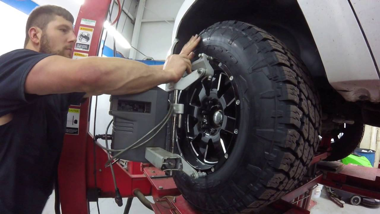 Chevy silverado getting 305/65r18 tires and a alignment ...