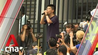 Hong Kong protests: Demonstrators gather occupy road outside police HQ