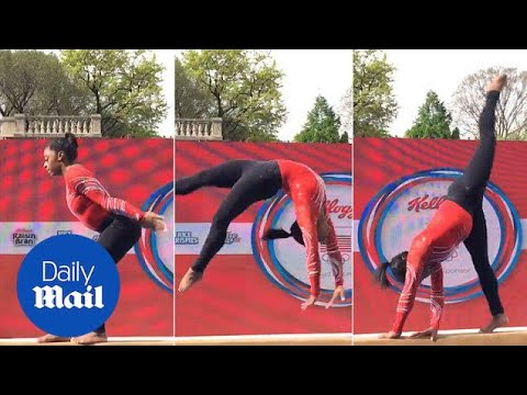Three-time World Champion Simone Biles shows off her moves - Daily Mail