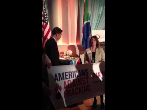 Flag exchange between South African and American anti-fracking activists