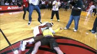 Repeat youtube video LeBron tackles Heat fan who hits $75,000 shot!