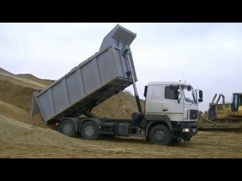 Самосвалы МАЗ-6501В9 разгружаются