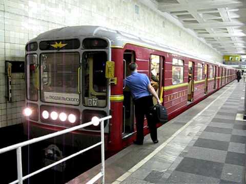 Red Arrow (Krasnaja Strela) train is departing from Sokolniki Station, Moscow subway.