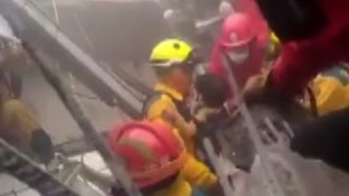 Rescuers pull children from earthquake rubble