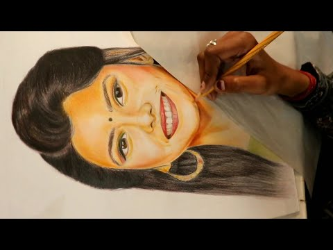 student-making-portrait-by-pencil-colours-at-tapan's-fine-arts-academy.-contact:-7011232533.