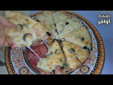 صورة  طريقة عمل البيتزا البيتزا التي خطفت قلوب الملايين مثل المطاعم عجينة هشة وجبنة مطاطية نتيجة رائعة طريقة عمل البيتزا من يوتيوب