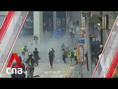 Hong Kong police fire tear gas in Central after lunch hour flash mob