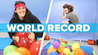 We Competed To Beat The World Record For Balloon Popping