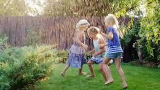 stock footage children playing in the summer garden grupa children have fun under water jets or rain