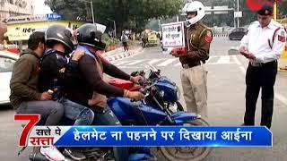 Satte Pe Satta: Delhi traffic cop holds up mirror to show helmet-less passenger