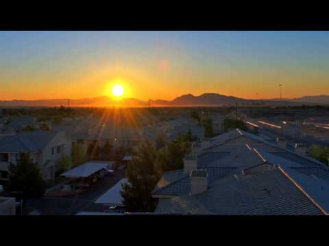 Sunrise Time Lapse HD Video 1080p Footage Views of Rising Sun over a City with Houses and Traffic