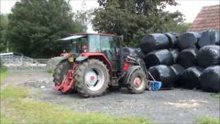 loading and unloading round bales