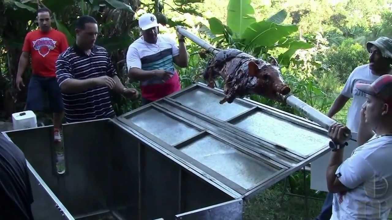 roasting a pork in puerto rico lechón asado en caja china
