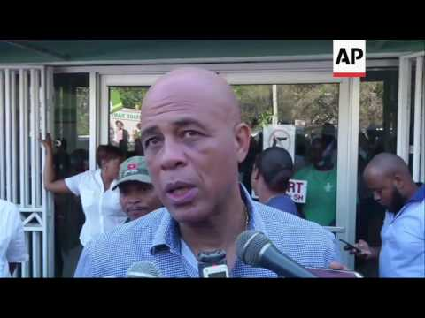 Haiti: Preval's body removed from hospital