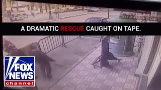 Dramatic rescue: Police catch falling child from third floor
