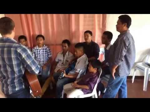 """Lawson bates singing """"just alittle talk with Jesus"""" with a group of children in tacloban"""