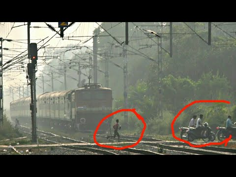 People Risking life in front of high speed train: 22121 LTT -Lucknow AC Sf express