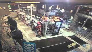 Surveillance video shows BP robbery, shootout