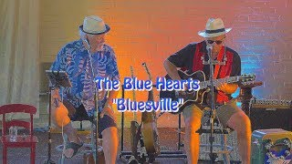 """The Blue Hearts are: Mark """"Westcoast"""" Comerford: Guitar & Percussio..."""