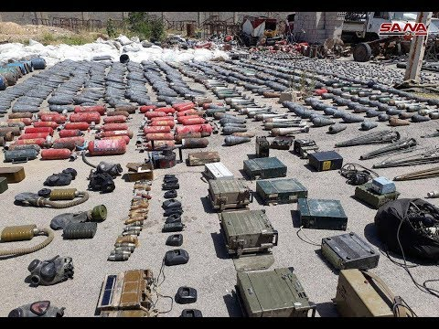 Syrian military seizes another large cache of weapons in southern Damascus photos