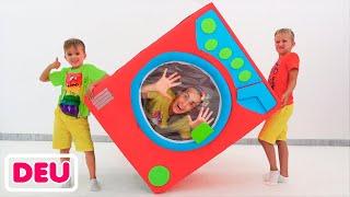 Vlad und Niki spielen mit spielzeugwaschmaschine