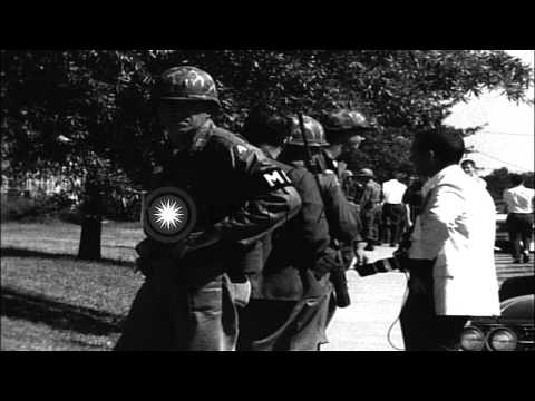 James Meredith leaves building during Mississippi riots. HD Stock Footage