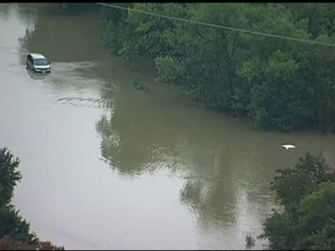 Raw: Cars Submerged By Flood Waters in Dallas