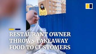 Coronavirus: Restaurant owner in China throws takeaway food to customers