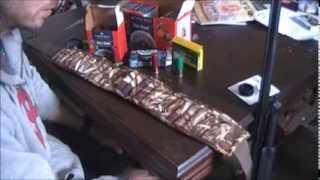Remington 870 Magnum 12 Gauge shotgun with Red Dot scope