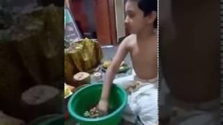 A Child doing Kanchi Mahaperiyava Anusham Pooja! by Panchanathan Suresh