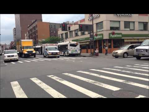 CITYWIDE EMS AMBULANCE RESPONDING ON W. 125TH ST. & 5TH AVE. IN HARLEM AREA OF MANHATTAN IN NYC.