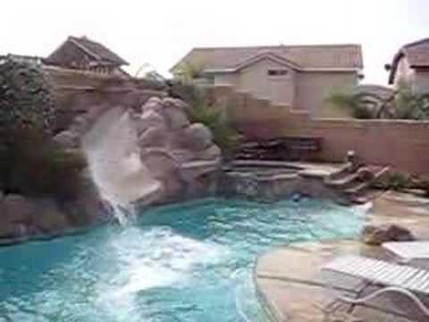 Dog Loves The Pool Slide