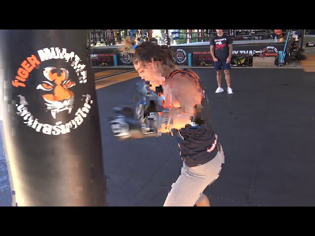 Claudia Diaz boxing heavy bag workout
