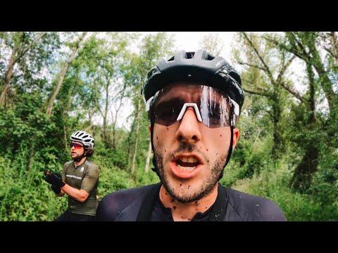 Two Guys Riding Bicycles Through Mud thumbnail