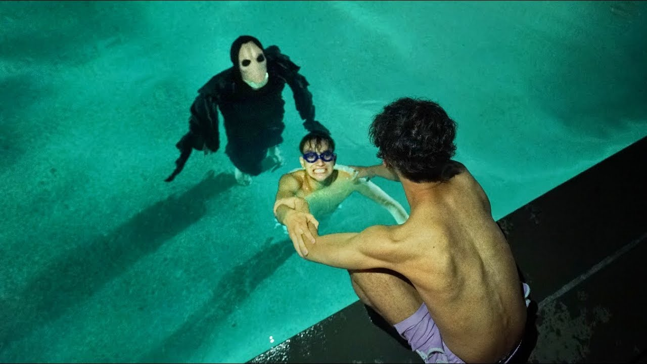 scary-monster-invades-our-swimming-pool-at-3am