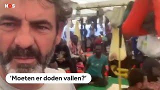 Open Arms filmt situatie aan boord Spaans migrantenschip