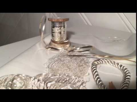 Selecting materials for embroidery in white and silver