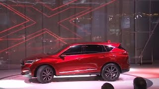 Behind the glitz at Detroit Auto Show, challenges remain for auto industry