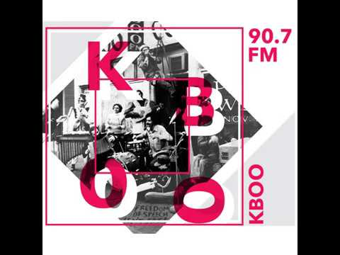KBOO's 50th - Slideshow of Calendar images featuring Norman Solomon