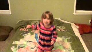 Dancing toddler head rolls off bed