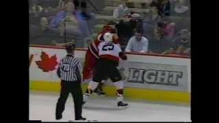 Jesse Boulerice ( Carolina Hurricanes ) knocks down Chris Neil ( Ot...