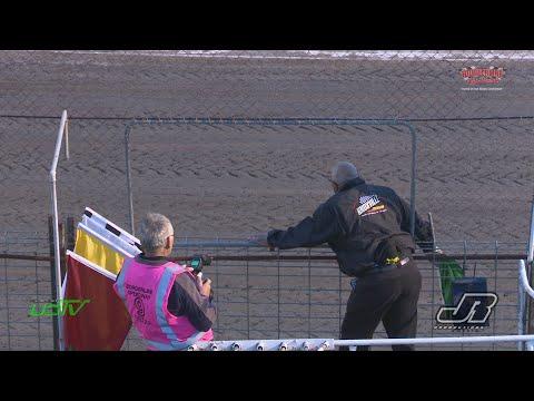 Knoxville Raceway flagman Doug Clarke waving the flags at Borderline Speedways Kings Challenge